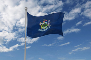 Maine flag waving in the sky