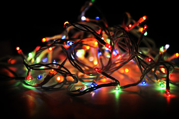 New Year's garland Electrical Power on black background