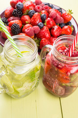 Fresh fruits flavored water in jars