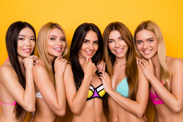 Multicultural colorful beauty, Group of five young playful coquettes in swim suits, all so hot and different, posing while enjoying on bachelorette hen party near pool, looking tempting and sensual