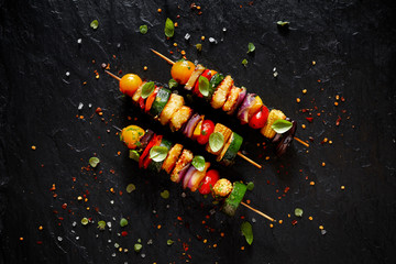 Aluminium Prints Grill / Barbecue Vegetarian skewers with halloumi cheese and mixed vegetables on black background, top view