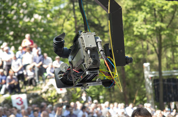 Piekary Sl, Poland, May 28, 2017: A TV camera on a jib over a crowd of men gathered at a men's clinic in Piekary Slaskie