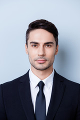 Close up cropped photo of a stylish young brunete lawyer bearded man, standing on pure background. He looks so classy! in a suit with tie