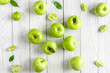 natural food design with green apples white desk background top view