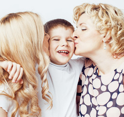 happy smiling family together posing cheerful on white background, lifestyle people concept, mother with son and teenage daughter isolated