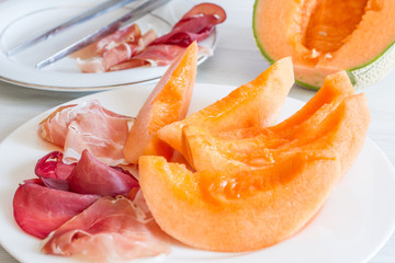 dish with melon and ham