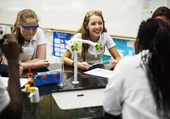 Group of school girls learning science class