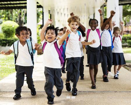 Group of diverse kindergarten students running cheerful after school