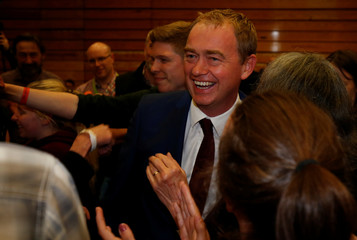 Tim Farron, leader of Britain's Liberal Democrat Party, and his wife Rosemary arrive at a counting centre during Britain's election in Kendal