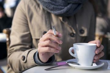 Woman smoking cigarette at cafe