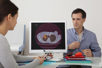 Models On screen, recolorized scanner of a lung cancer