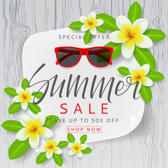 Beautiful background with flowers for summer sale. Beautiful background with plumeria flowers on wooden texture. Vector illustration with paper.