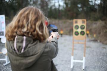 Girl shooting at outdoor gun range