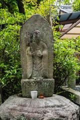 Stone buddha monk statue