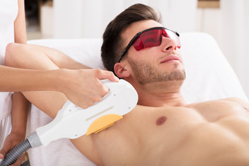 Man Having Underarm Laser Hair Removal Treatment