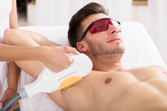 Man Having Underarm Laser Hair Removal Treatment