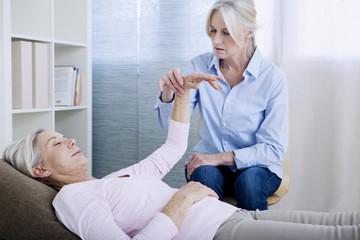 Senior woman undergoing hypnosis session