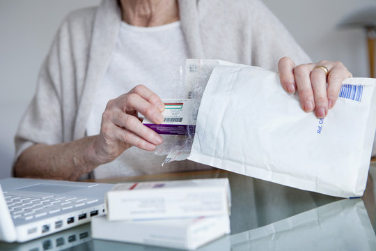 Senior woman receiving medicines bought on internet