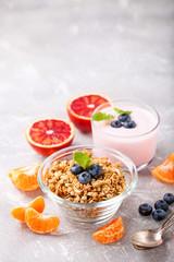 Healthy breakfast - muesli, yogurt and fruit. Selective focus. Copy space