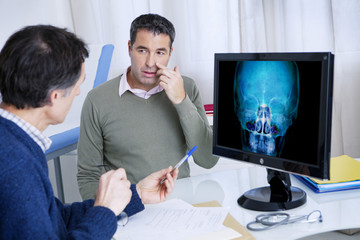 Male patient consulting for sinusitis