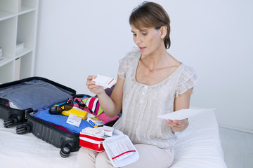 Woman preparing her travel first aid kit