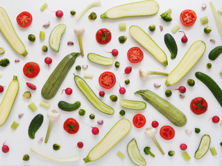 Zucchini, tomatoes, cucumbers, garlic on a white background. Vegetable pattern. Abstract food background. Top view.