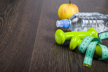 Dumbbells and a bottle of water