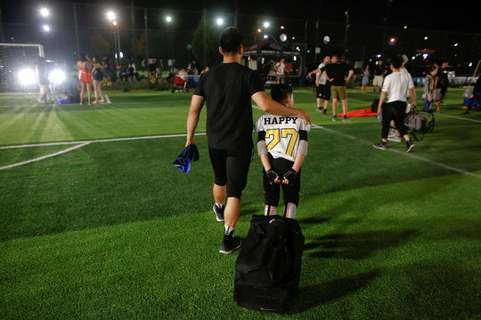 A player of the Eagles leaves the pitch after his team defeated the Sharklets in the Future League American football youth league in Beijing