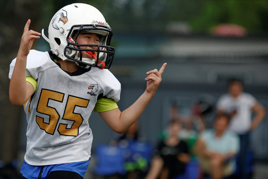 An Eagles player celebrates during a training session of the Future League American football youth league team in Beijing