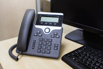 Office phone, computer, keyboard.