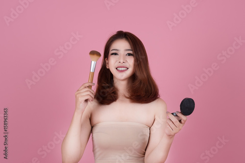 51a332c758 Beautiful Young Woman perfect happy and smile with cosmetic in hand. Facial  treatment . Cosmetology
