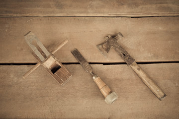 wood carpenter tools chisel and hammer in vintage style