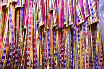 It is a woven textile with a shiny surface and colourful vertical stripes, made with silk warps and cotton wefts in it's hometown Gaziantep, Turkey.