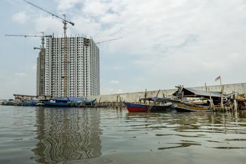 Sunda Kelapa old Harbour with fishing boats, ship and docks in Jakarta, Indonesia