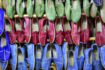 Yemeni is a kind of shoe that flat heeled with red or black goat skin coat and water buffalo skin sole. in this hometown Gaziantep, Turkey