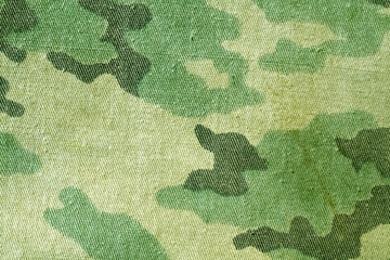 Dirty old camouflage uniform pattern.