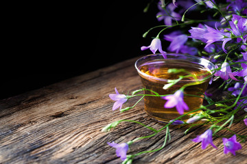 Bouquet of herbs - scattered bells, field caviar on a wooden table. Herbal tea.