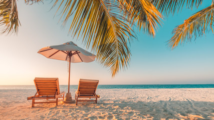 Papiers peints Plage Beautiful beach. Chairs on the sandy beach near the sea. Summer holiday and vacation concept. Inspirational tropical beach. Tranquil scenery, relaxing beach, tropical landscape design. Moody landscape
