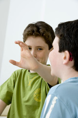 Models Do not use for HIV Young boy using the French sign language to discuss with his hearing-impaired brother The French sign language uses signs to designate words but also dactylology (each letter of the alphabet is represented by a defined position of the fingers then enabling to spell a word) and the lip reading The young boy designates the letter \c\ (see image nᄚ0833202 ans series of images from nᄚ0572308 to 0574108 to see the other letters of the alphabet)