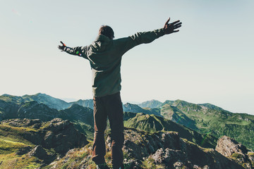 Traveler Man raised hands over mountains Travel Lifestyle emotional concept adventure summer vacations outdoor hiking mountaineering harmony with nature