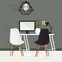 pair of chair in empty working space with computer monitor and lamp