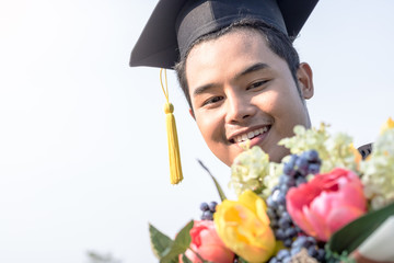 student graduate holding Flower bouquet in hand