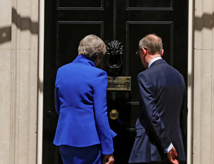 Britain's Primer Minister Theresa May and her husband walk into number 10 Downing Street after she addresses the country in London