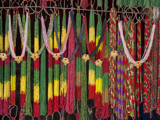 Asian hand made strands colorful beads at outdoor crafts market in Kathmandu, Nepal.