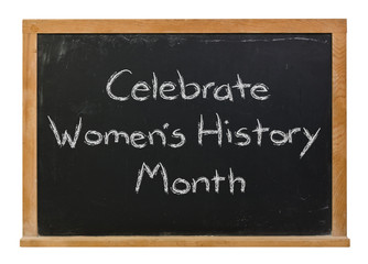 Celebrate Women's History Month written in white chalk on a black chalkboard isolated on white
