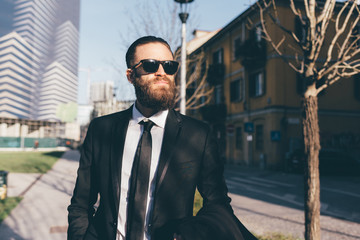 Waist up young handsome caucasian bearded businessman