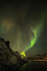 Aurora borealis (Polar lights) over the mountains in the North of Europe - Senja Island, Troms, Norway