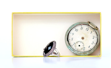 fashion ring with black gem in an old  carton box