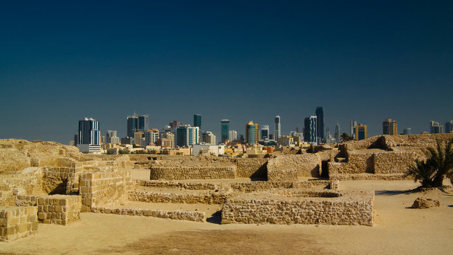 Ruins of Qalat fort and Manama in Bahrain