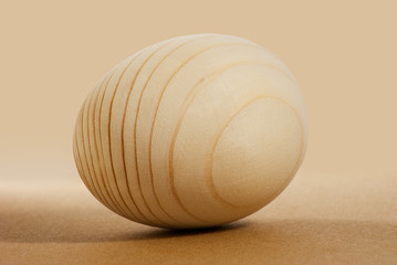 Image of wooden egg close up